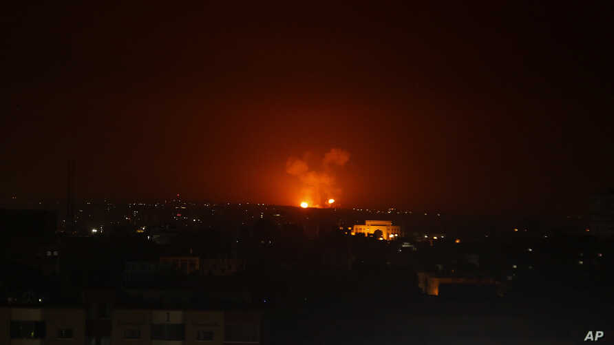 An explosion by Israeli airstrikes is seen in Gaza City early Monday, Feb. 24, 2020. Israel's military says it struck Palestinian militants in Gaza and Syria after they fired some 20 rockets toward southern Israel.