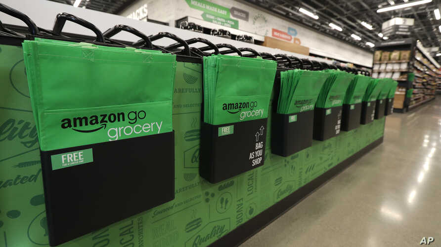 Reusable shopping bags are displayed inside an Amazon Go Grocery store set to open soon in Seattle's Capitol Hill neighborhood, Feb. 21, 2020.