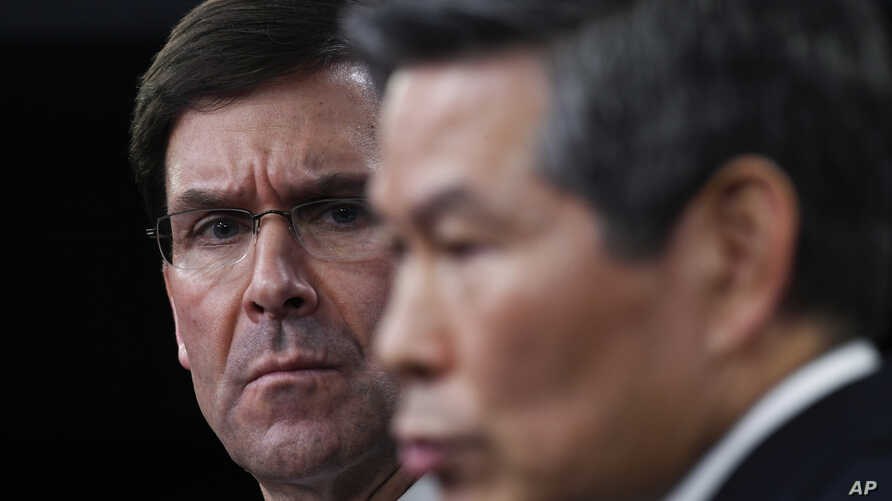 Defense Secretary Mark Esper, left, listens as South Korean National Defense Minister Jeong Kyeong-doo, right, speaks during a…