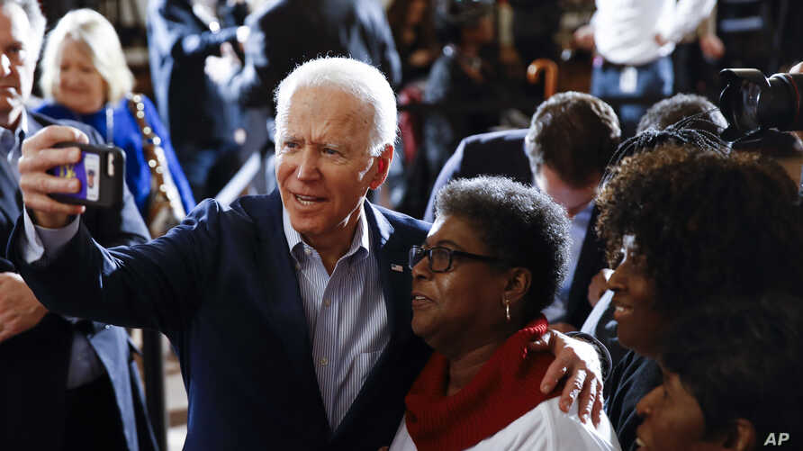 Democratic presidential candidate former Vice President Joe Biden meets with attendees during a campaign event, Feb. 26, 2020, in Charleston, S.C.