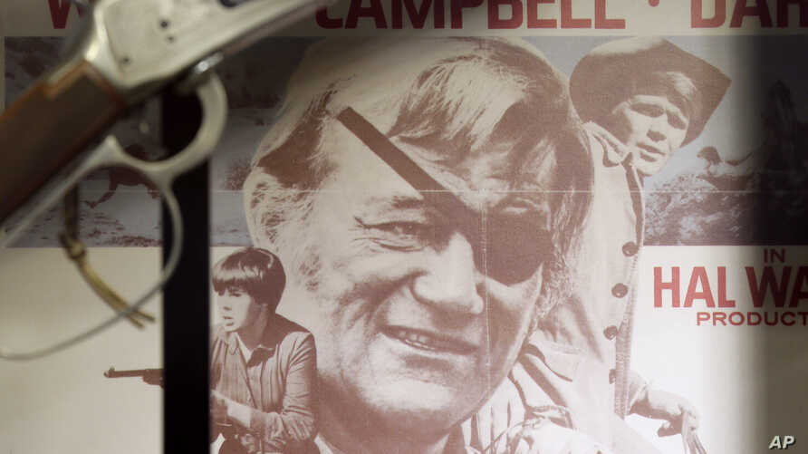 A movie poster from True Grit is shown in a display case in the John Wayne Museum, Thursday, May 14, 2015, in Winterset, Iowa…