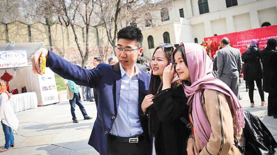 Chinese tourists take a selfie in Iran in this undated photo published by the Donya-e-Eqtesad newspaper in December 2019 (Credit