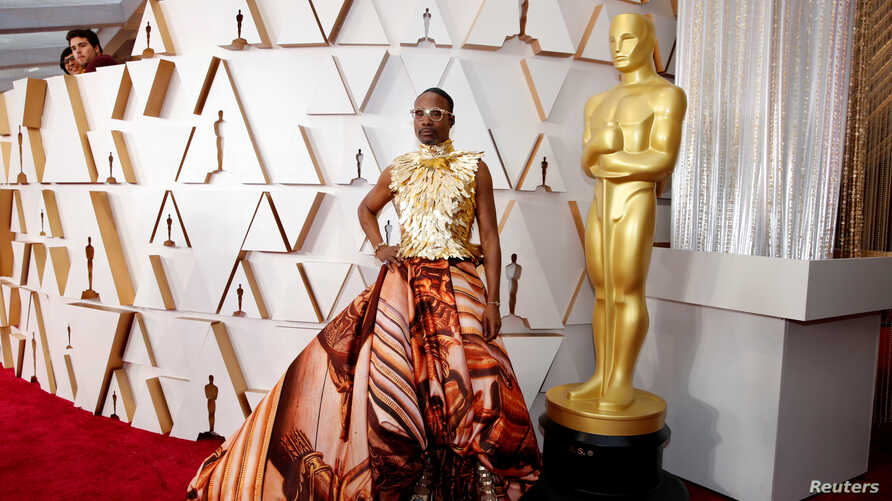 Billy Porter in Giles Deacon and shoes by Jimmy Choo poses on the red carpet during the Oscars arrivals