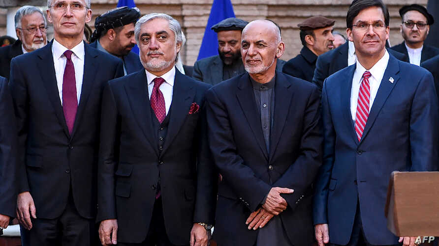 From left, NATO Secretary General Jens Stoltenberg (L) Afghan opposition presidential candidate Abdullah Abdullah, Afghan President Ashraf Ghani, and U.S. Secretary of Defense Mark Esper pose for a photo at the presidential palace in Kabul Feb. 29, 2020.