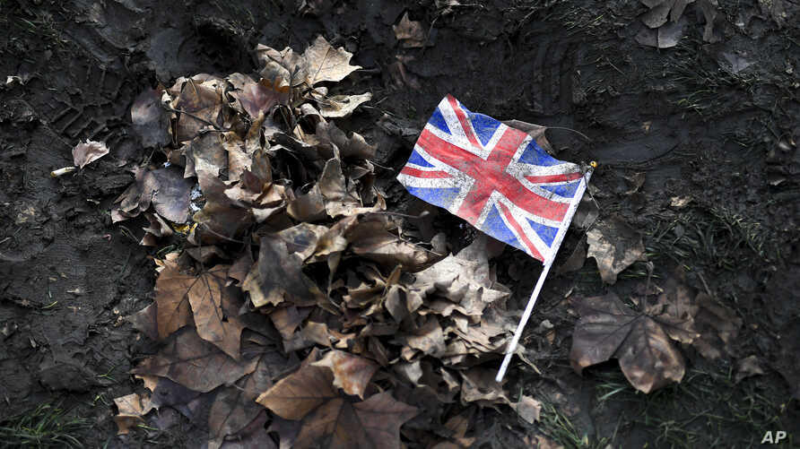 FILE - A British Union flag lies on the ground in Parliament Square, London, Feb. 1, 2020.