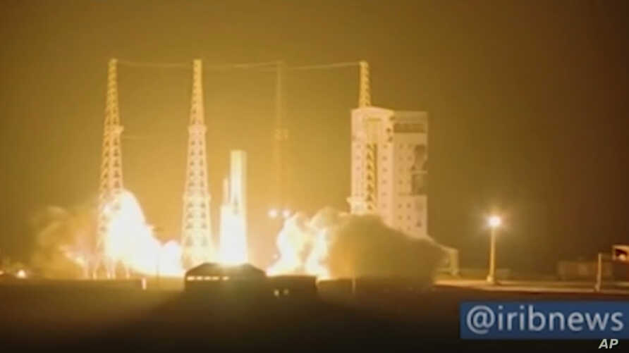 In this image taken from video an Iranian rocket carrying a satellite is launched from Imam Khomeini Spaceport in Iran's Semnan province, some 230 kilometers (145 miles) southeast of Iran's capital, Tehran, Feb. 9, 2020.
