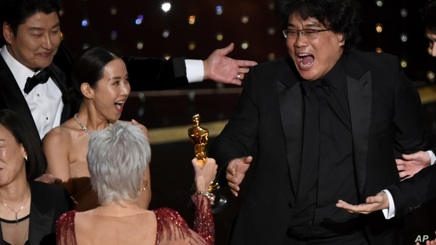 """Bong Joon Ho, right, reacts as he is presented with the award for best picture for """"Parasite"""" from presenter Jane Fonda at the Oscars, Feb. 9, 2020, at the Dolby Theatre in Los Angeles, California."""