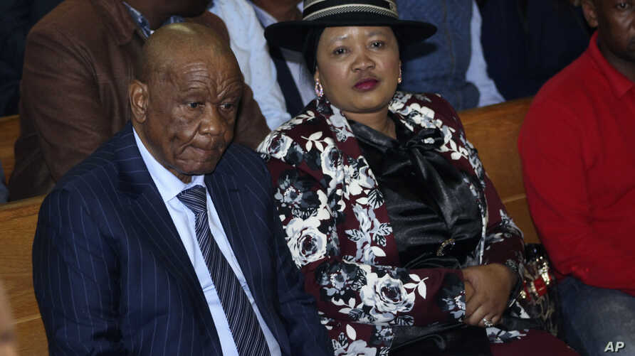 Lesotho's Prime Minister Thomas Thabane, left, and his wife Maesaiah, right, appear in court in Maseru, Feb. 24, 2020.