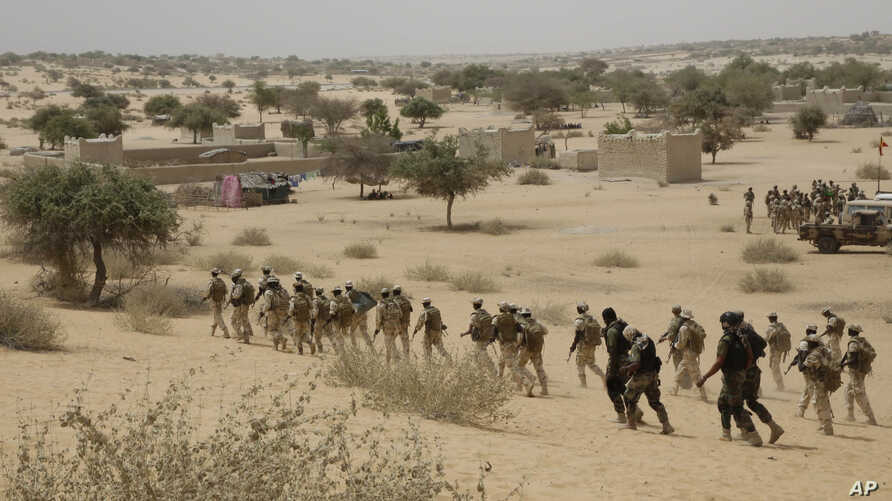 FILE - Chadian troops and Nigerian special forces participate in exercises in Mao, Chad, March 7, 2015.