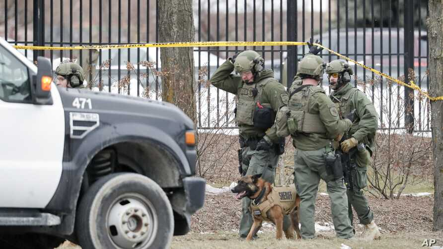 Police work outside the Molson Coors Brewing Co. campus in Milwaukee, Wisconsin, Feb. 26, 2020, after reports of a shooting.