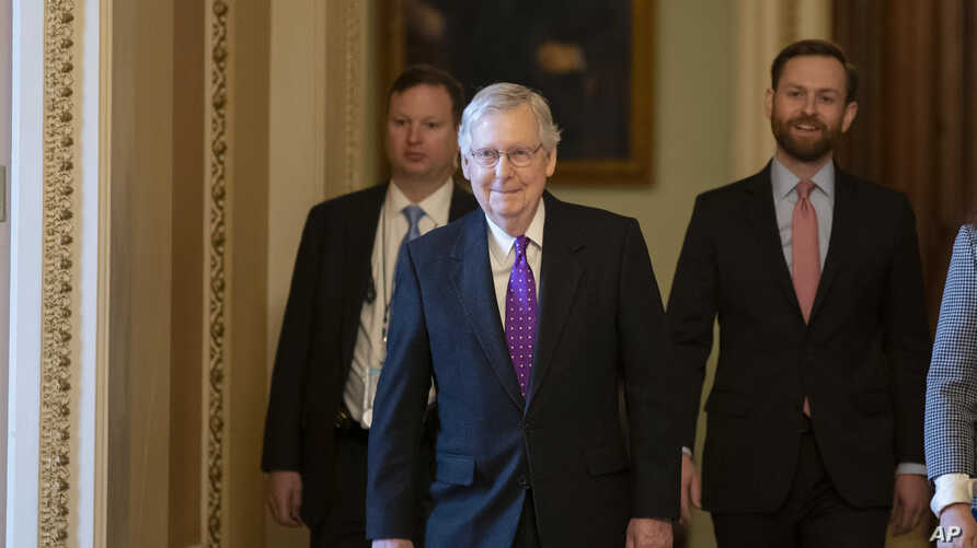 Senate Republican Majority Leader Mitch McConnell, center, leaves the Senate Chamber on Capitol Hill, in Washington, Feb. 4, 2020.
