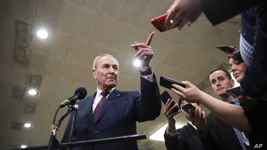 Senate Democratic Minority Leader Chuck Schumer speaks to the media after leaving the Senate chamber on Capitol Hill in Washington, Feb. 3, 2020.