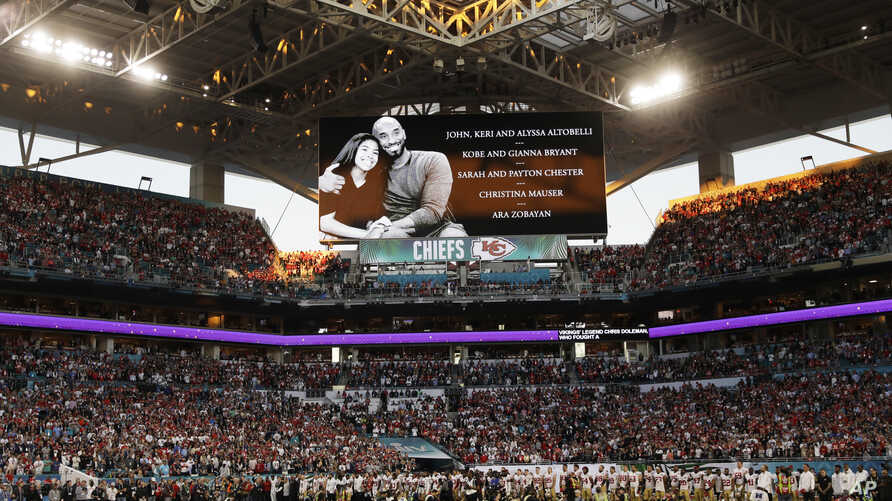 Players stand during a tribute to Kobe and Gianna Bryant and other victims of a helicopter crash before the NFL Super Bowl 54 football game between the San Francisco 49ers and Kansas City Chiefs, at Hard Rock Staqdium in Miami, Florida, Feb. 2, 2020.