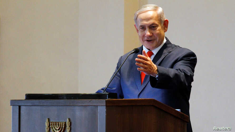 FILE - Israeli Prime Minister Benjamin Netanyahu gestures as he speaks during a news conference at the State House, in Entebbe, Uganda, Feb. 3, 2020.