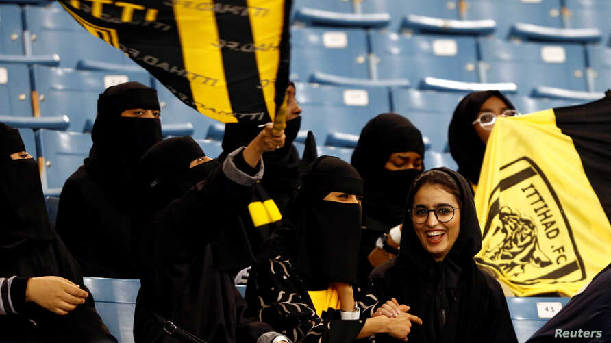 FILE - Saudi women watch a soccer match at King Fahd Stadium in Riyadh, Saudi Arabia, Jan. 13, 2018.