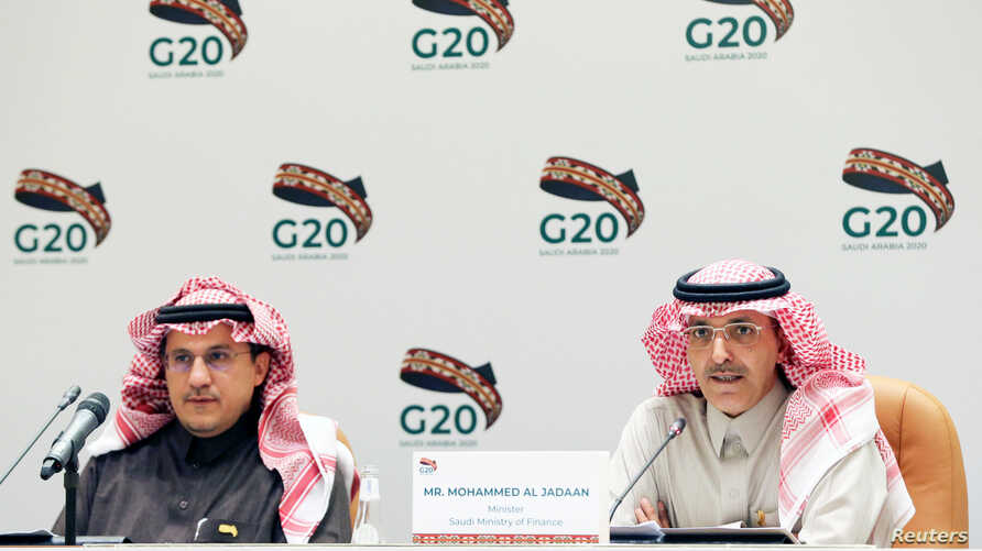 Saudi Minister of Finance Mohammed al-Jadaan, right, speaks during a media conference with central bank governor Ahmed al-Kholifey, in Riyadh, Saudi Arabia, Feb. 23, 2020.
