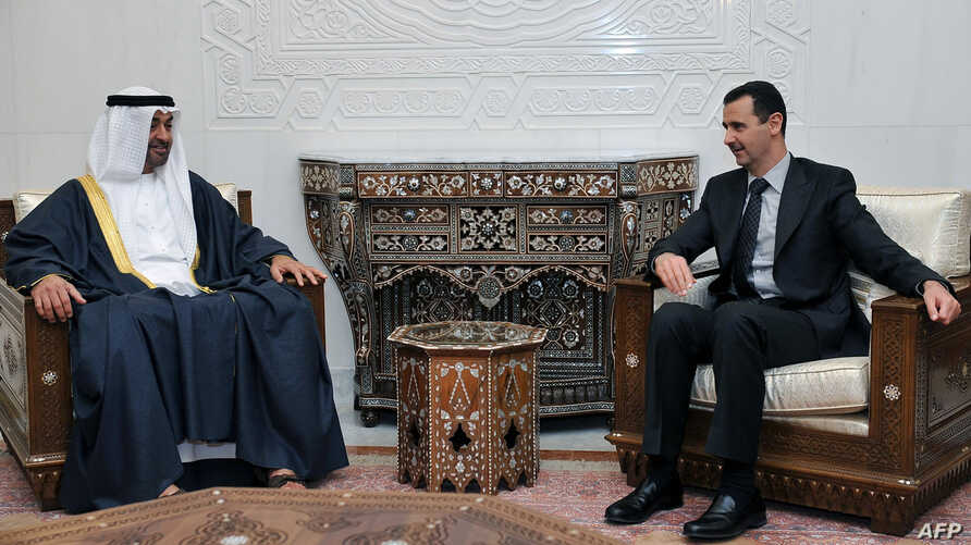 (FILES) A file handout photo released on January 13, 2009 shows Syrian President Bashar al-Assad (R) meeting with Abu Dhabi's…