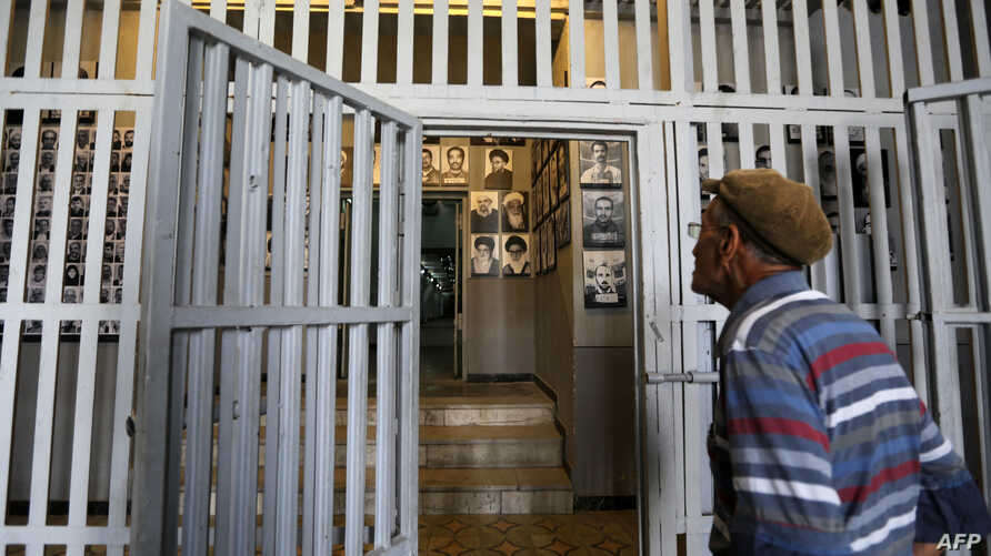 """An Iranian man visits on September 2, 2014 the """"Qasr prison"""", a former prison hosting political prisoners that was turned into…"""