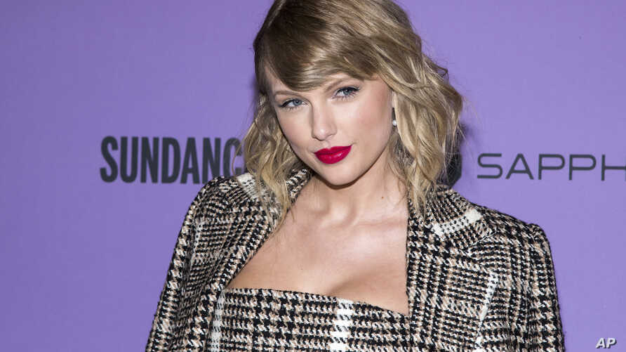 "FILE - Taylor Swift attends the premiere of ""Taylor Swift: Miss Americana"" at the Eccles Theater during the 2020 Sundance Film Festival on Thursday, Jan. 23, 2020, in Park City, Utah."
