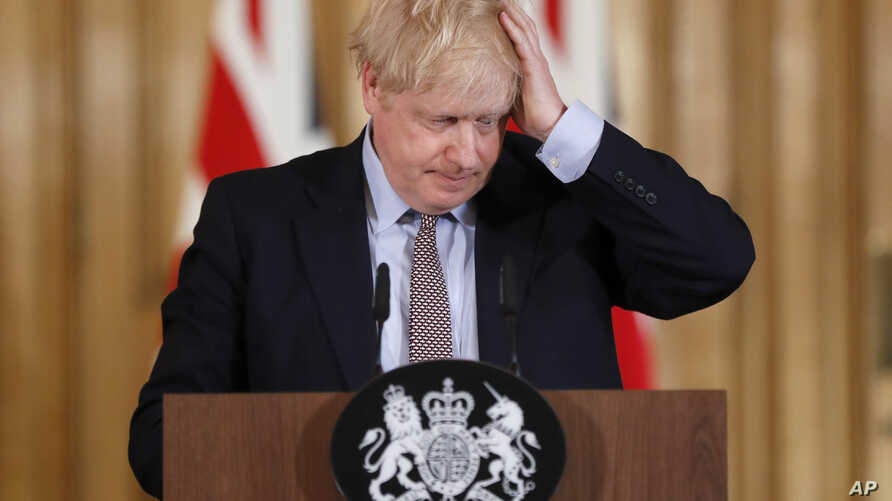 Britain's Prime Minister Boris Johnson reacts during a press conference at Downing Street on the government's coronavirus action plan in London, March 3, 2020.