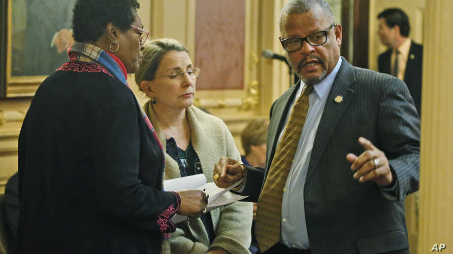 Del. Delores McQuinn, D-Richmond, left, speaks with State Sen. Siobhan Dunnavant, R-Henrico, center, and Del. Luke tori, D-Prince William, right during the House session at the Capitol, March 7 , 2020, in Richmond, Virginia.