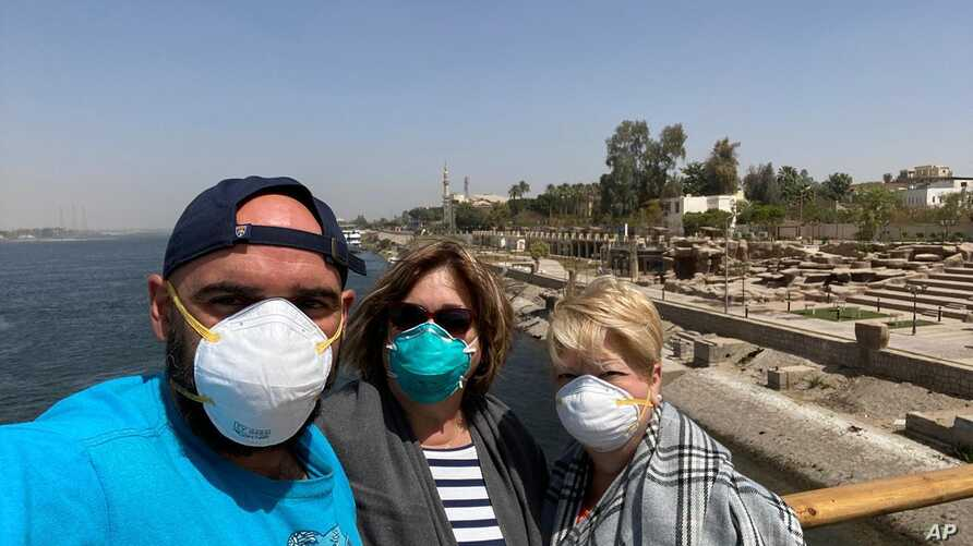 This photo provided by Javier Parodi, shows a selfie of Javier Parodi, left, Grissel Parodi and Amy Khamissian, on board the Nile cruise ship MS Asarade, in Luxor, Egypt, March 10, 2020.