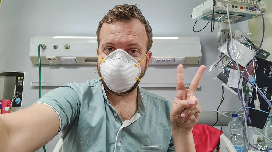 In this photo provided by Matt Swider, posted on Twitter on March 9, 2020, American tourist Matt Swider, takes a selfie while in quarantine in the north coast city of Marsa Matrouh, Egypt.