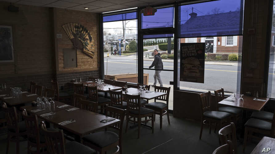 Clean tables await customers at the Eden Wok restaurant in New Rochelle, N.Y., March 12, 2020.