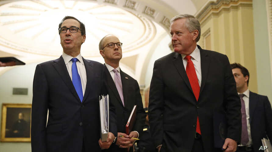 Treasury Secretary Steven Mnuchin, left, White House Legislative Affairs Director Eric Ueland and acting White House chief of staff Mark Meadows