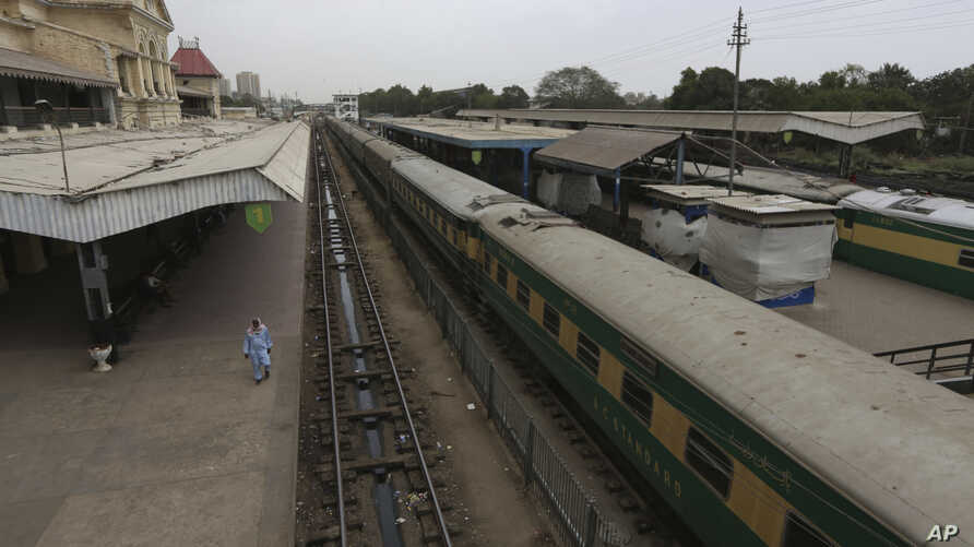 A railway station is deserted after authorities shut down railway service in an effort to contain the new coronavirus, in Karachi, Pakistan Wednesday, March 25, 2020.