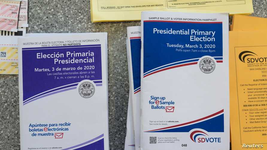 English and Spanish-language sample ballots and voter information pamphlets for the California Democratic presidential primary…