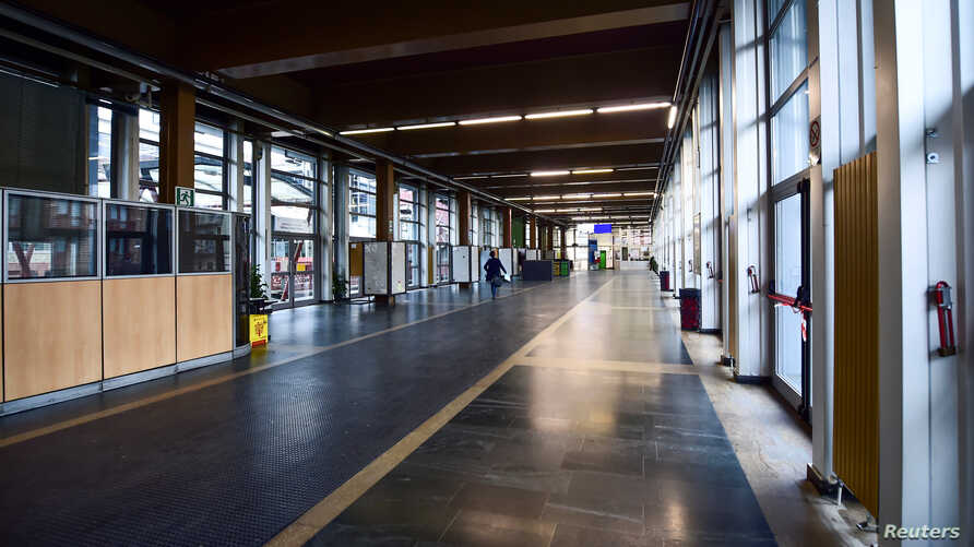 An empty hall in Palazzo Nuovo University of Turin is pictured after the government's decree to close cinemas, schools and urge…