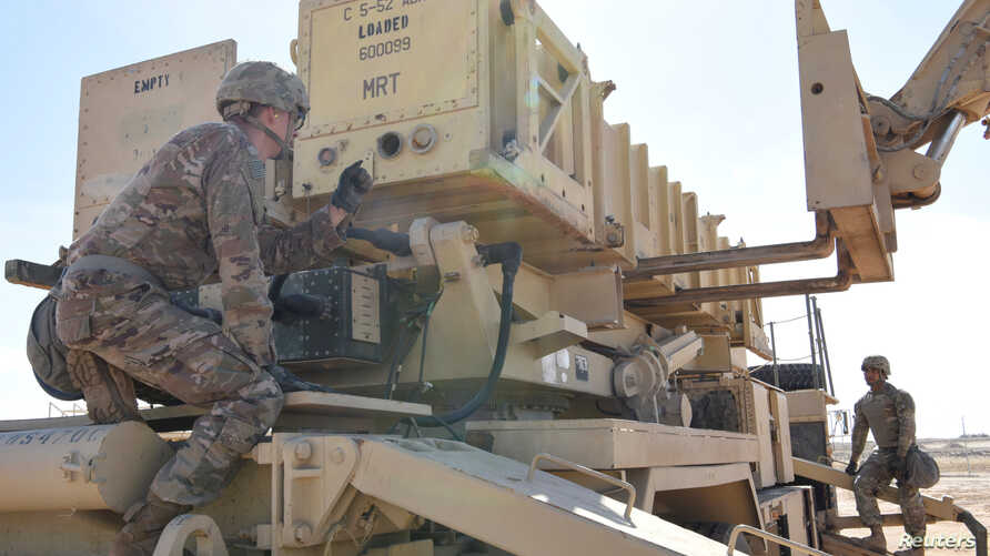 Specialist Tevin Howe and Specialist Eduardo Martinez take part in training on a U.S. Army Patriot surface-to-air missile…
