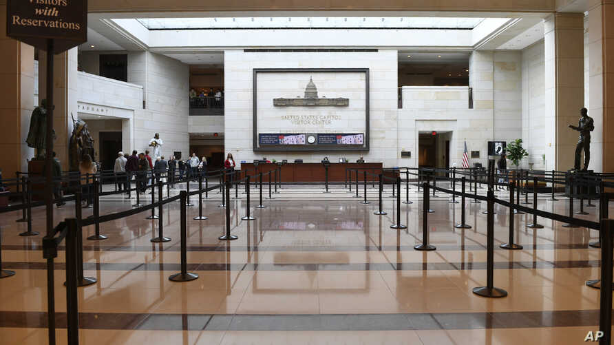 A smaller number of tourists visit the Capitol Visitors Center on Capitol Hill in Washington, March 12, 2020. Congress is shutting the Capitol to the public until April in reaction to the spread of the coronavirus, officials announced Thursday.