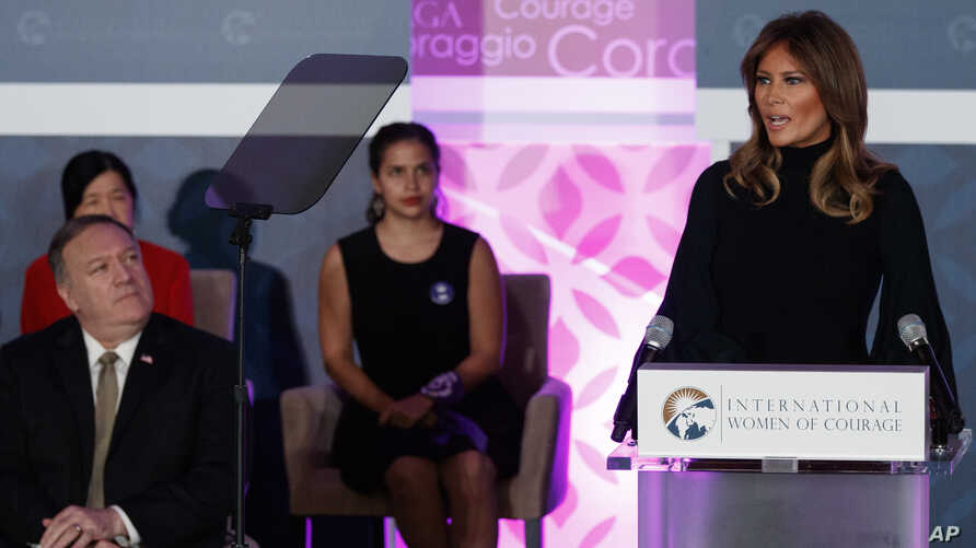First lady Melania Trump speaks during the 2020 International Women of Courage Awards Ceremony at the State Department in Washington, Feb. 4, 2020, as Secretary of State Mike Pompeo, seated left, looks on.