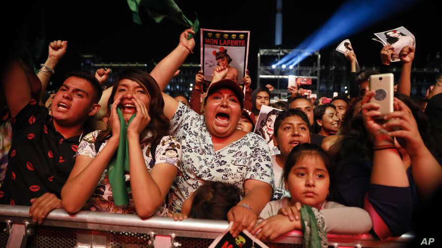 """Spectators chant """"Justice"""" in Spanish during a concert by female performers on the eve of International Women's Day, in the Zocalo in Mexico City, March 7, 2020."""