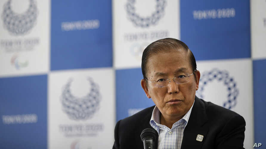 FILE - Toshiro Muto, CEO of the 2020 Tokyo Olympics organizing committee, listens to questions from the media during a news conference in Tokyo, June 11, 2019.