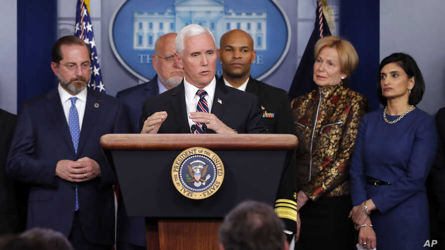 FILE - Vice President Mike Pence, flanked by administration officials, including Health and Human Services Secretary Alex Azar (L), speaks about the coronavirus outbreak, in the briefing room of the White House in Washington, March, 9, 2020.