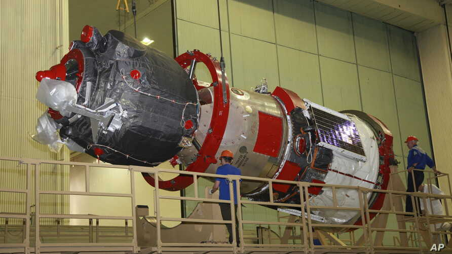 FILE - In this photo taken July 28, 2019, and distributed by the Roscosmos Space Agency Press Service, a Soyuz MS-14 capsule is being prepared for launch at Russia's space facility in Baikonur, Kazakhstan.