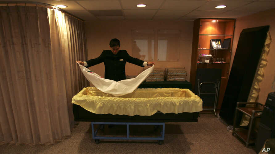 FILE - A funeral home employee prepares a coffin at a mortuary in Taipei, Taiwan, Jan. 16, 2010. A new law that bars news media from disclosing various types of information about suicides is stirring debate in Taiwan.
