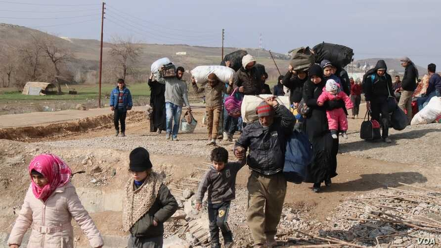 More than 11 million Syrians are displaced at home or abroad, with many having fled their homes several times. Some are pictured here in Manbij, Syria, Feb. 21, 2020. (Heather Murdock/VOA)