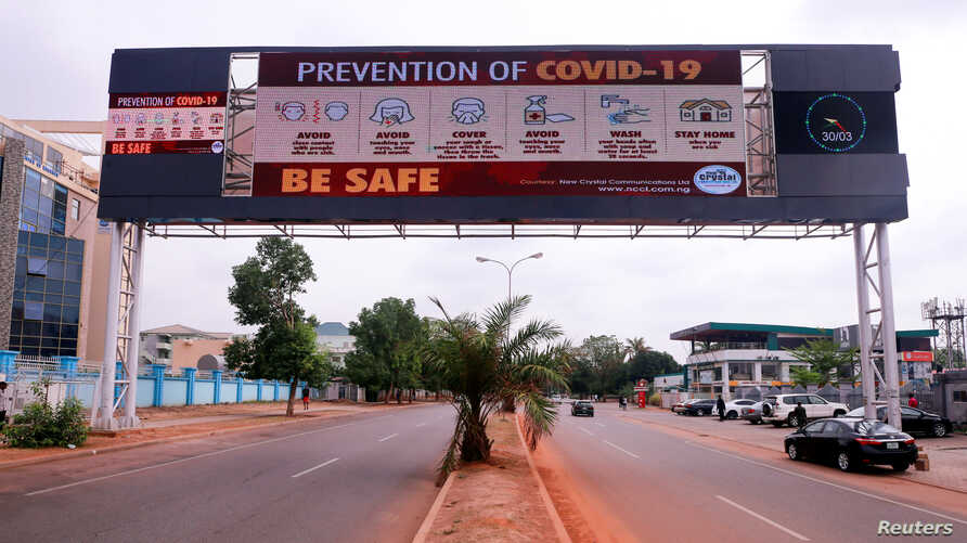 A few cars are pictured on a road, as authorities try to limit the spread of the coronavirus disease (COVID-19) in Abuja, Nigeria, March 30, 2020.