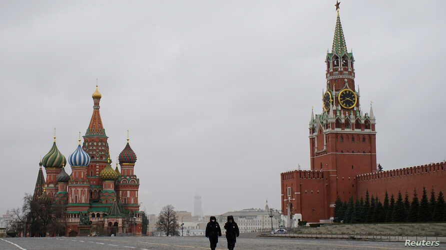 Police officers walk along the Red Square after the city authorities announced a partial lockdown to prevent the spread of coronavirus disease (COVID-19), in central Moscow, Russia, March 30, 2020.