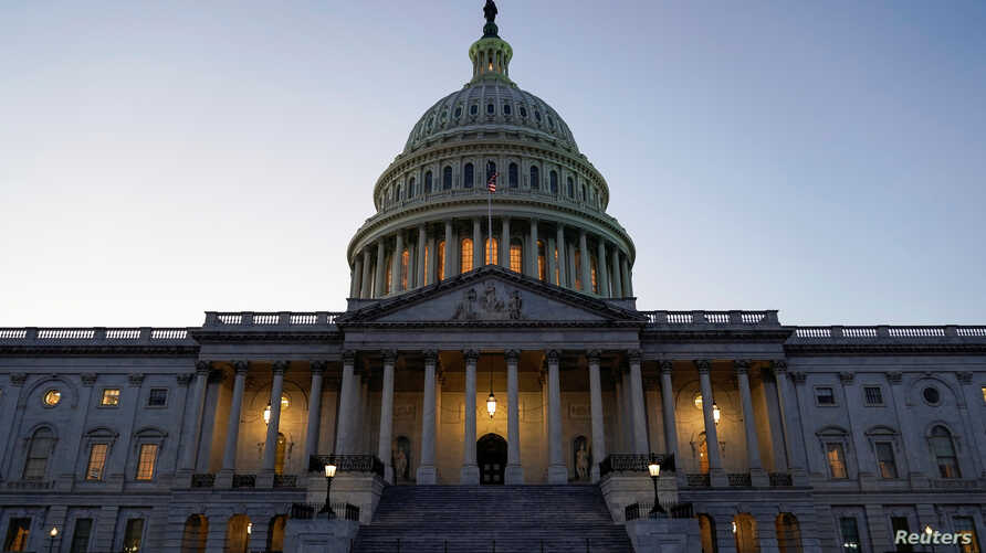 Lights shine from the U.S. Capitol dome prior to a vote in the U.S. House of Representatives on two articles of impeachment…