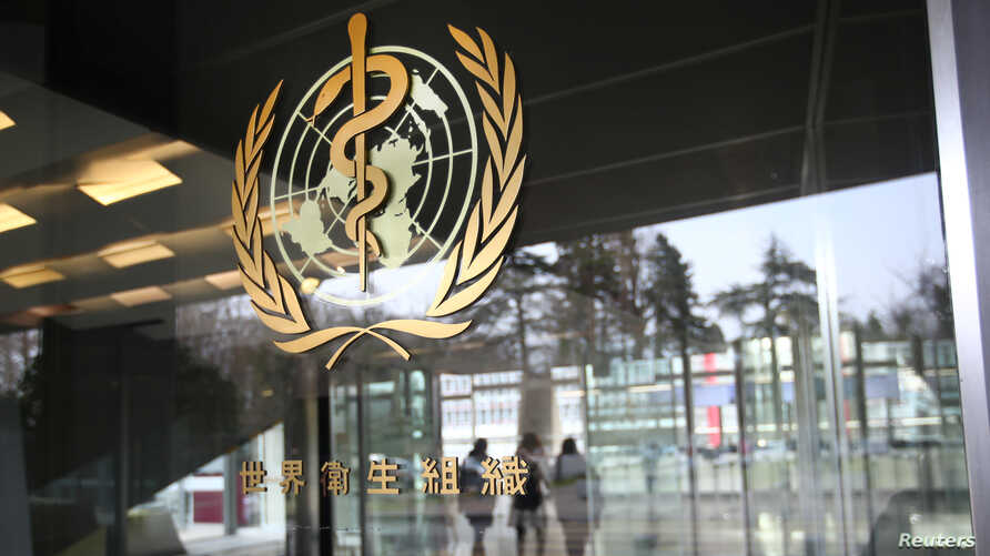 A logo is pictured outside a building of the  World Health Organization (WHO) during an executive board meeting on update on…