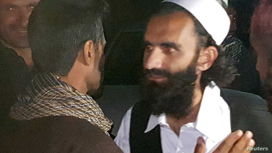 A newly freed Taliban prisoner greets his relatives outside Bagram prison, north of Kabul, Afghanistan April 8, 2020. REUTERS…