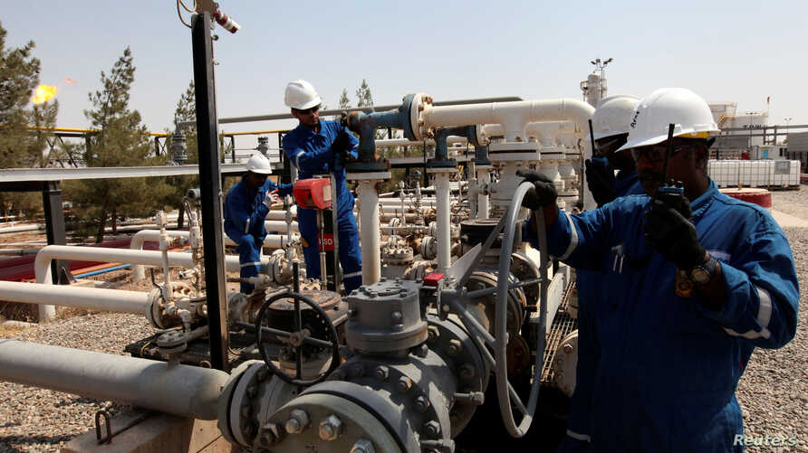 FILE PHOTO: Workers check the valves at the Taq Taq oil field in Arbil, in Iraq's Kurdistan region, August 16, 2014.   Picture…