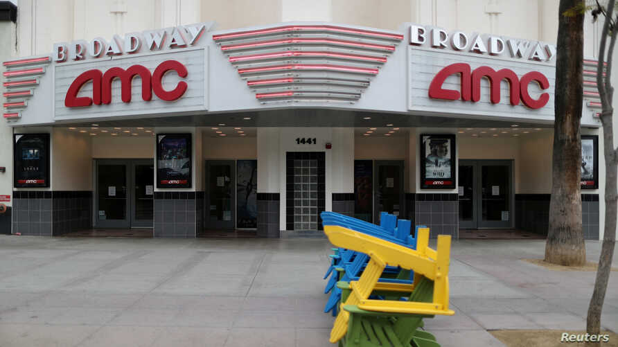 FILE PHOTO: Deckchairs sit stacked outside a closed movie theater during the global outbreak of coronavirus (COVID-19) in Santa…