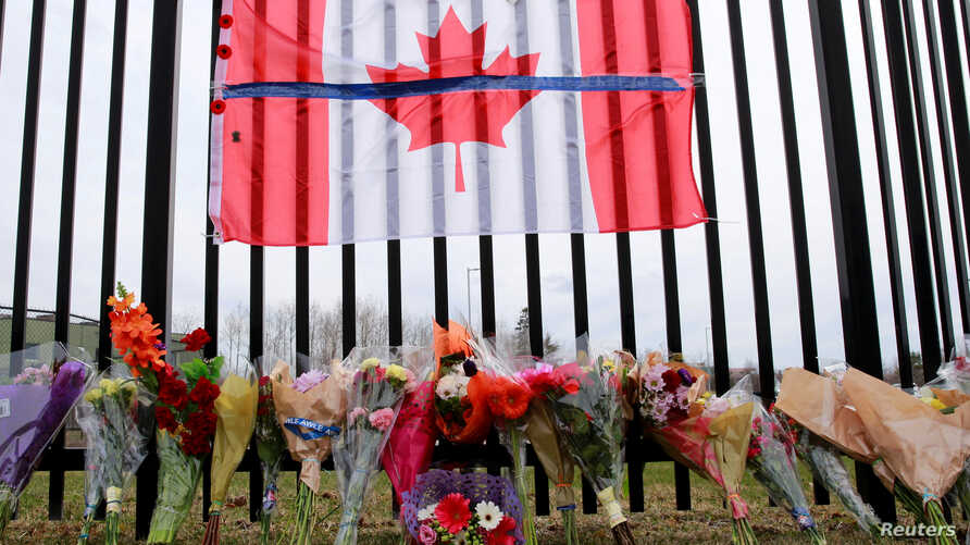 A memorial for Const. Heidi Stevenson is seen outside the Royal Canadian Mounted Police (RCMP) Headquarters, in Dartmouth, Nova…