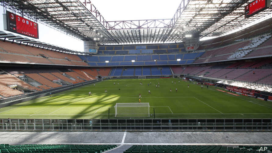 FILE - A view of the empty San Siro stadium during the Serie A soccer match between AC Milan and Genoa, in Milan, Italy, March 8, 2020.